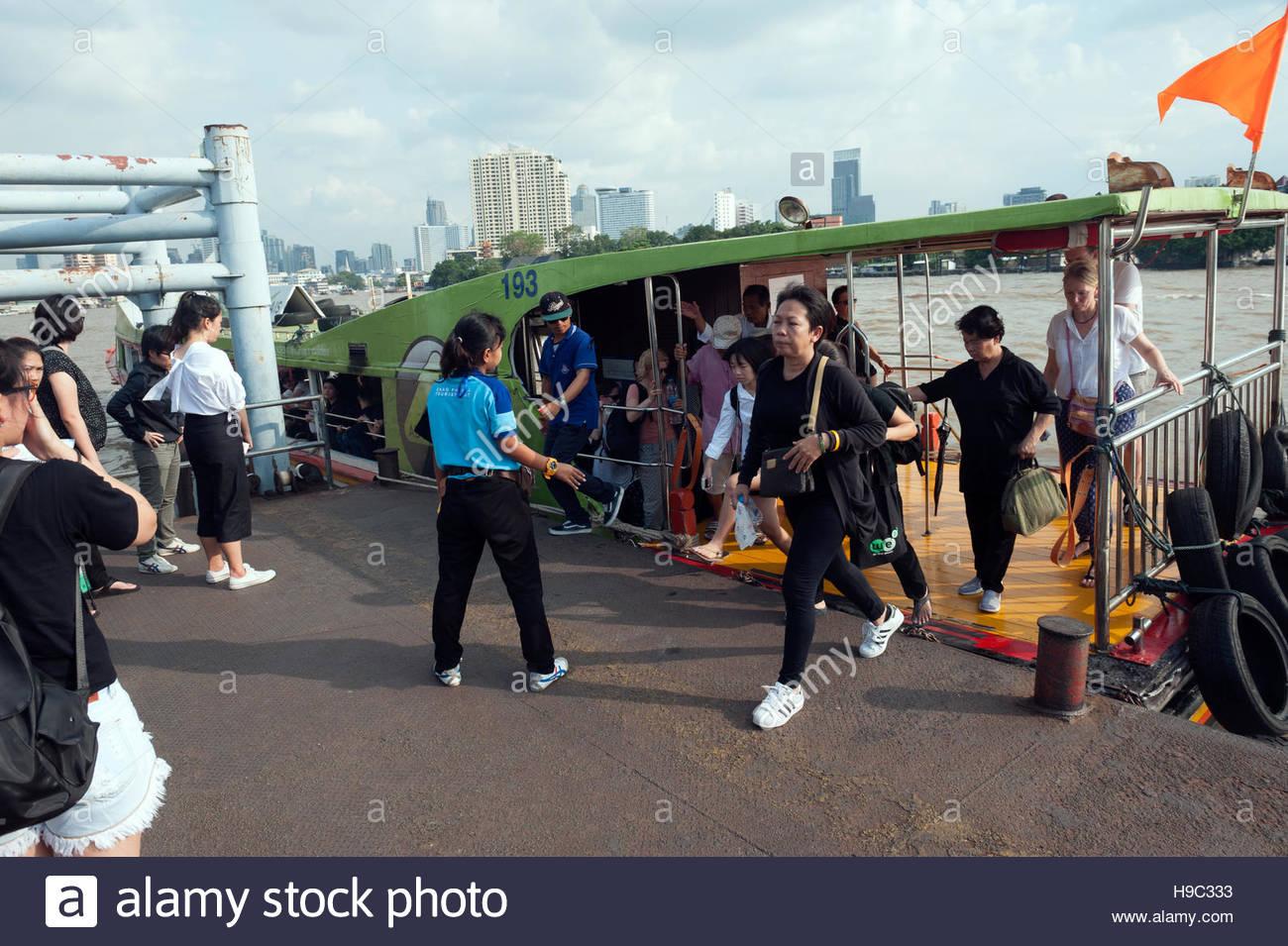 Bangkok Thailand Passenger boats on the Chao Phraya River. - Stock Image
