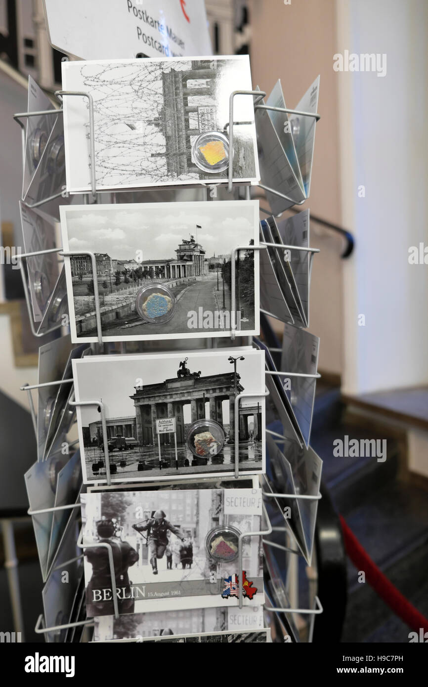 Fragments of the original Berlin Wall attached to postcards for sale to tourists at Brandenburg Gate tourist store - Stock Image