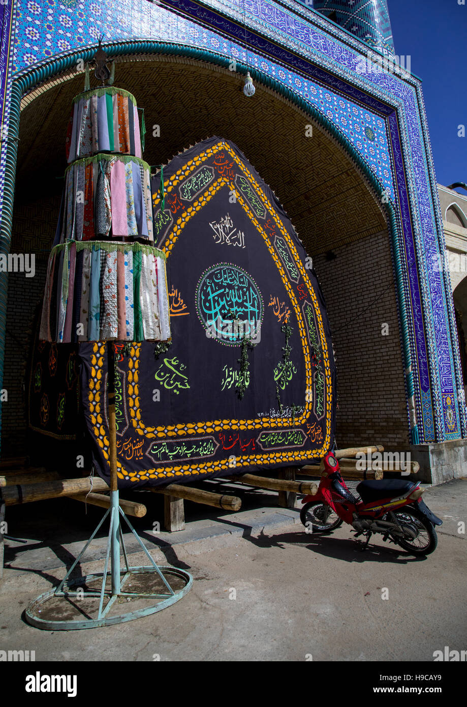 A nakhl and an alam made of clothes in front of a mosque during muharram to commemorate the martyrdom anniversary - Stock Image
