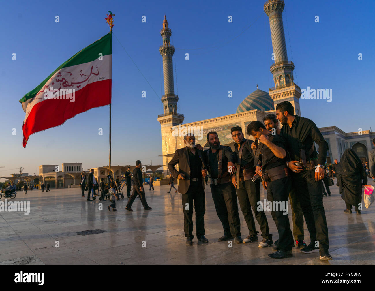 Alam carriers posing in front of imam hassan mosque during muharram, Central county, Qom, Iran - Stock Image