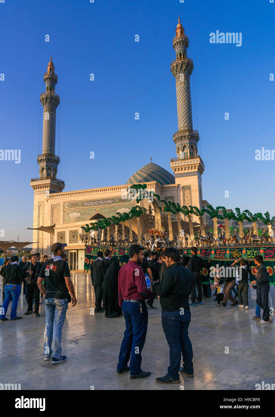 Alam procession during muharram celebrations in fatima al-masumeh shrine, Central county, Qom, Iran - Stock Image