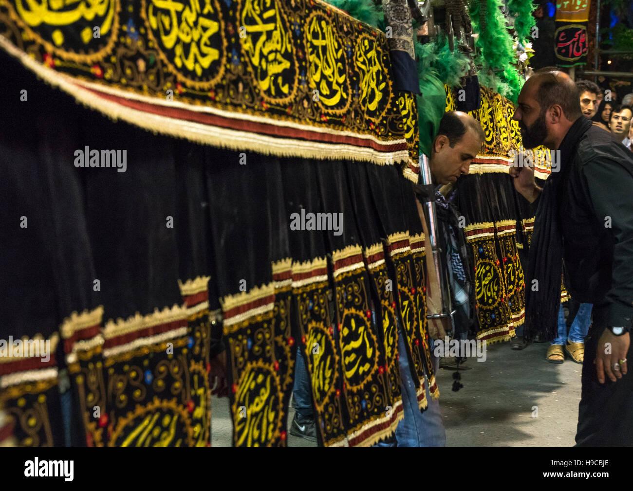 Iranian shiite muslim men carrying an alam during muharram, Lorestan province, Khorramabad, Iran - Stock Image