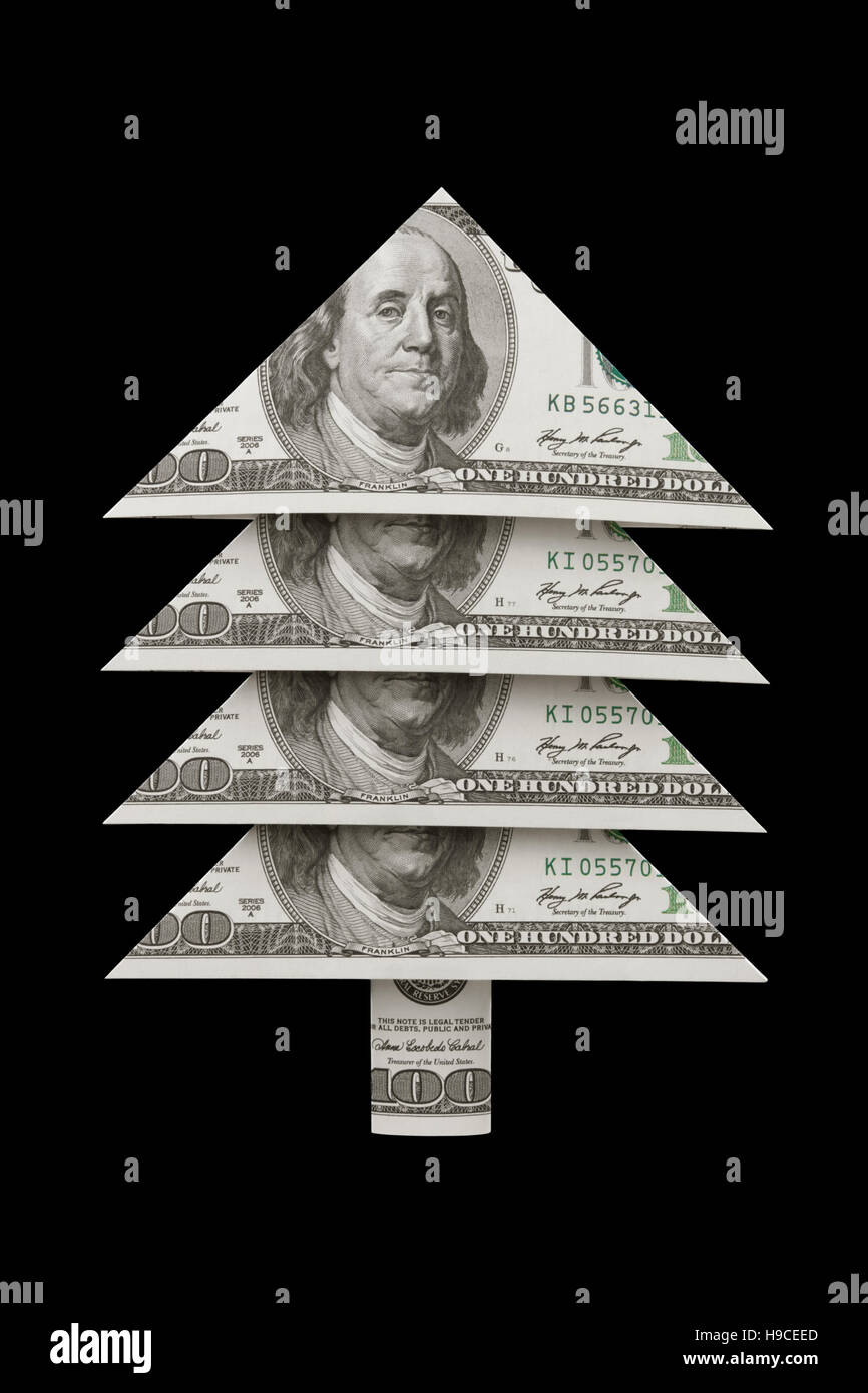 Christmas symbol and metaphor (dollars fur-tree). Black background. Available in high-resolution and several sizes. - Stock Image