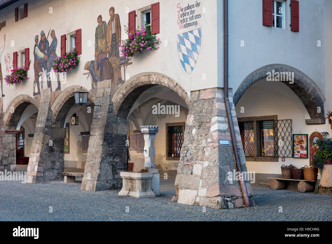 Murals - Lueftlmalerei, painted on the walls above the walkway surrounding the Schlossplatz in Berchtesgaden, Bavaria, - Stock Image