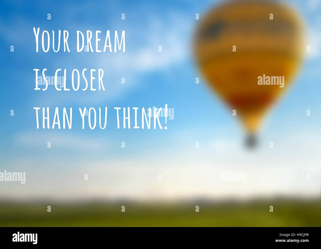 Vector blurred background with a balloon and an inspiring motto, eps10. - Stock Vector