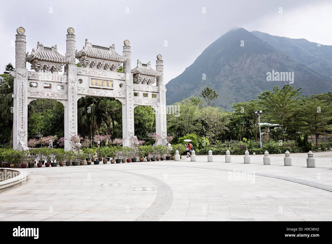 Entrance to Po Lin Monastery with mountain in background, Lantau Island, Hong Kong - Stock Image
