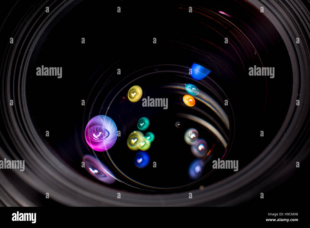 Colorful light shapes in lens - Stock Image