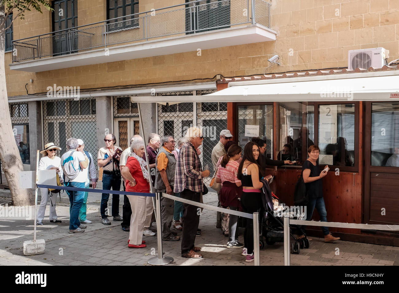 People queue at the border control between the Greek Cypriot and Turkish Cypriot areas in Nicosia, Cyprus. - Stock Image