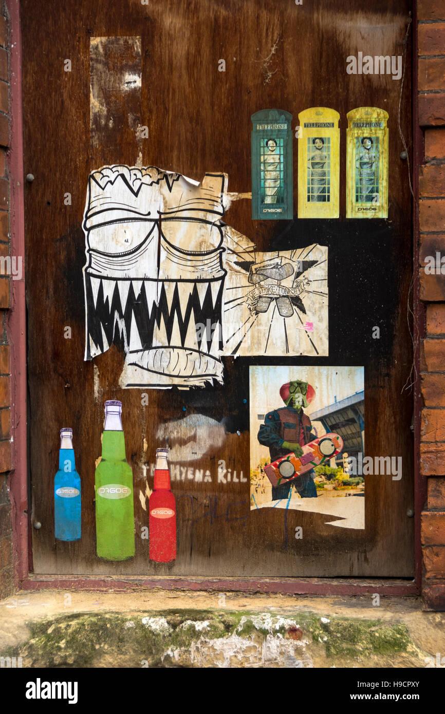 Mural on a door, Spear Street, Northern Quarter, Manchester, UK - Stock Image