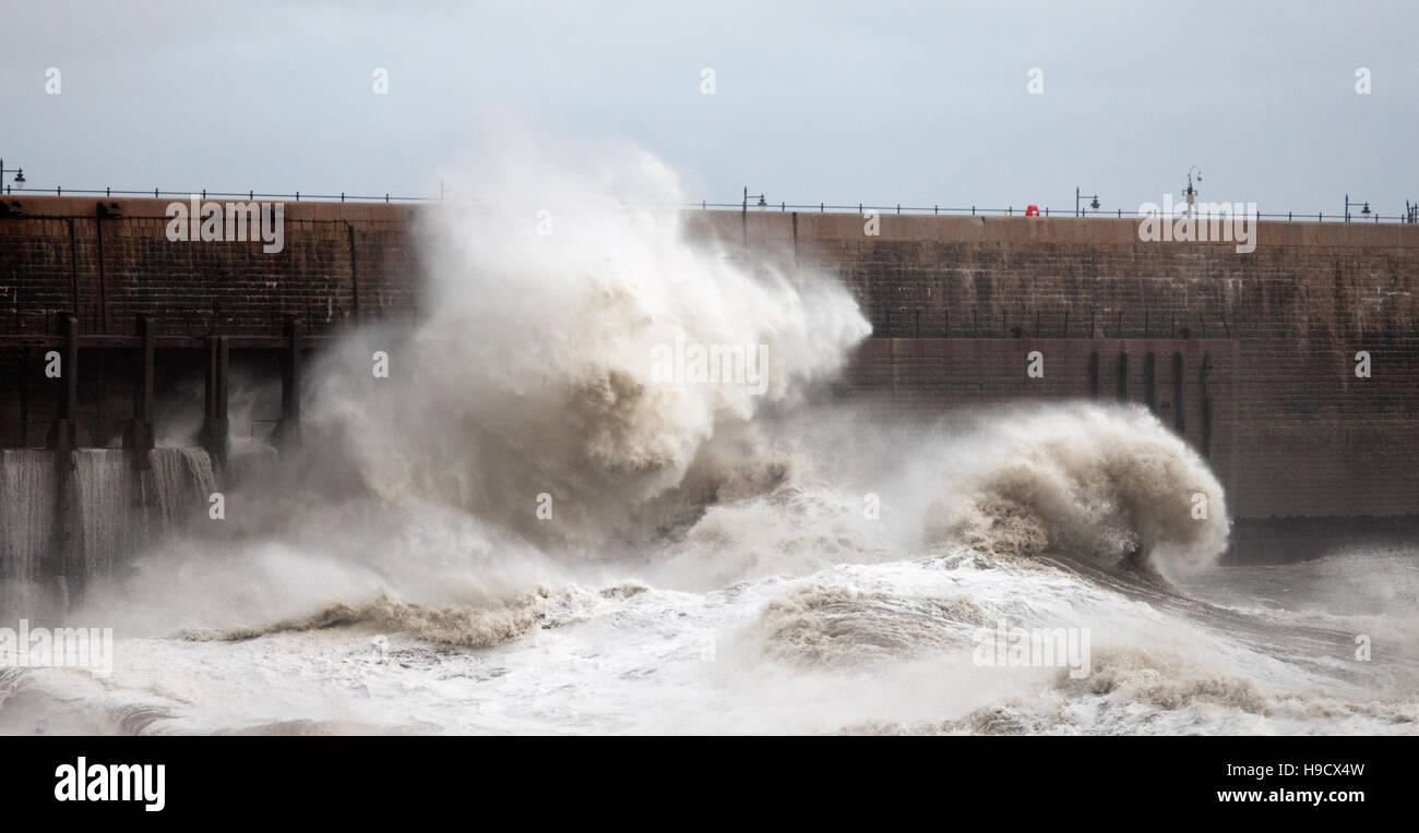 Storm waves hit the Old Harbour Wall Folkestone during Storm Angus - Stock Image