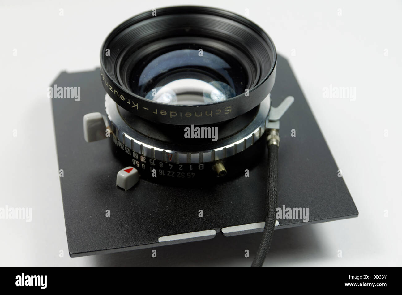 Schneider Kreuznach 150mm large format camera lens on lens board. - Stock Image