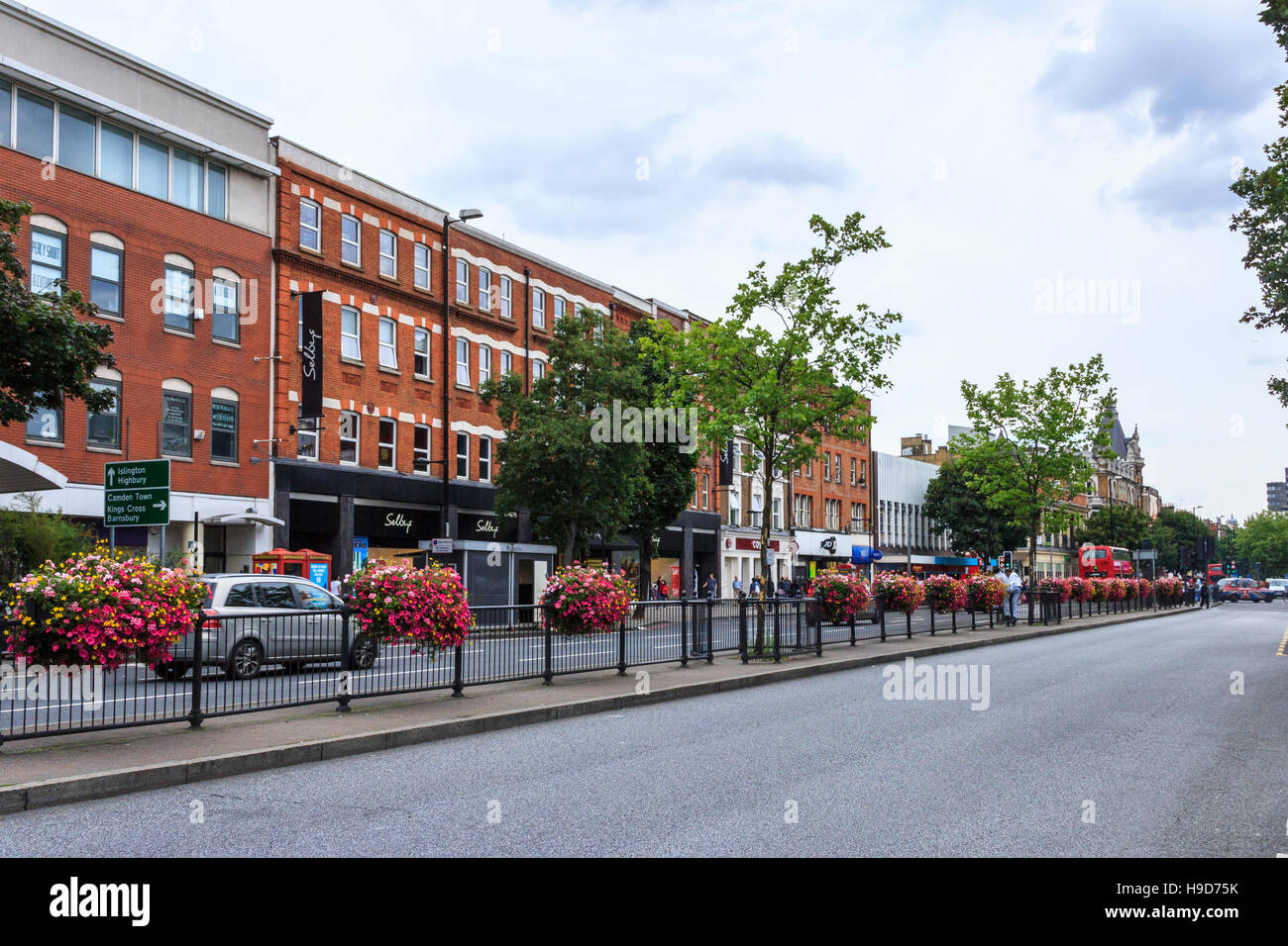 A view south along Holloway Road, North London, UK, after resurfacing and before road marking had been reapplied - Stock Image