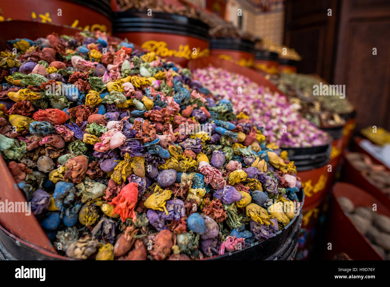 Colorful dried cactus flowers, herbs and spices in traditional Moroccan market in Marrakesh. Stock Photo
