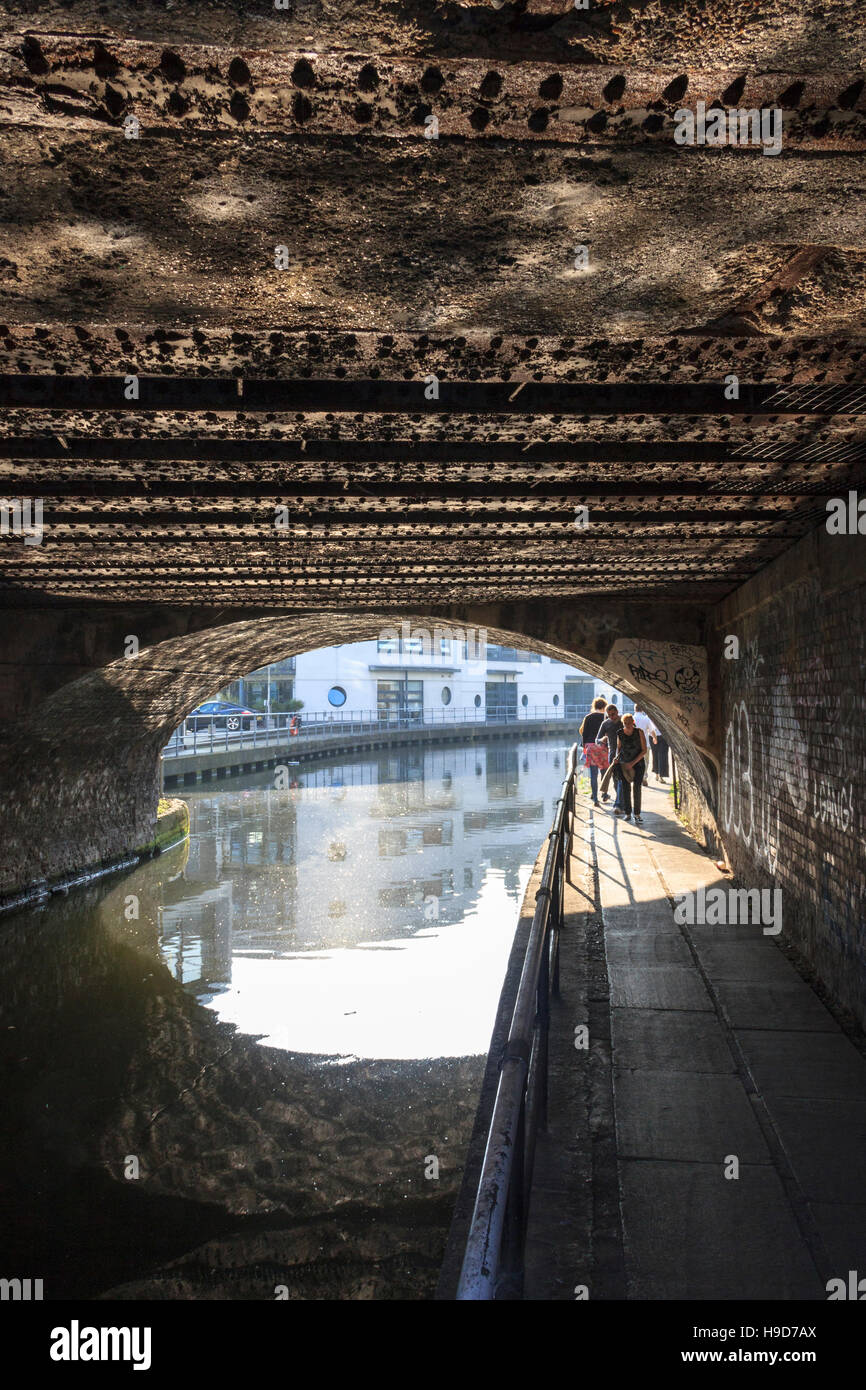 Towpath under a bridge on Regent's Canal, St. Pancras Way, London, UK - Stock Image