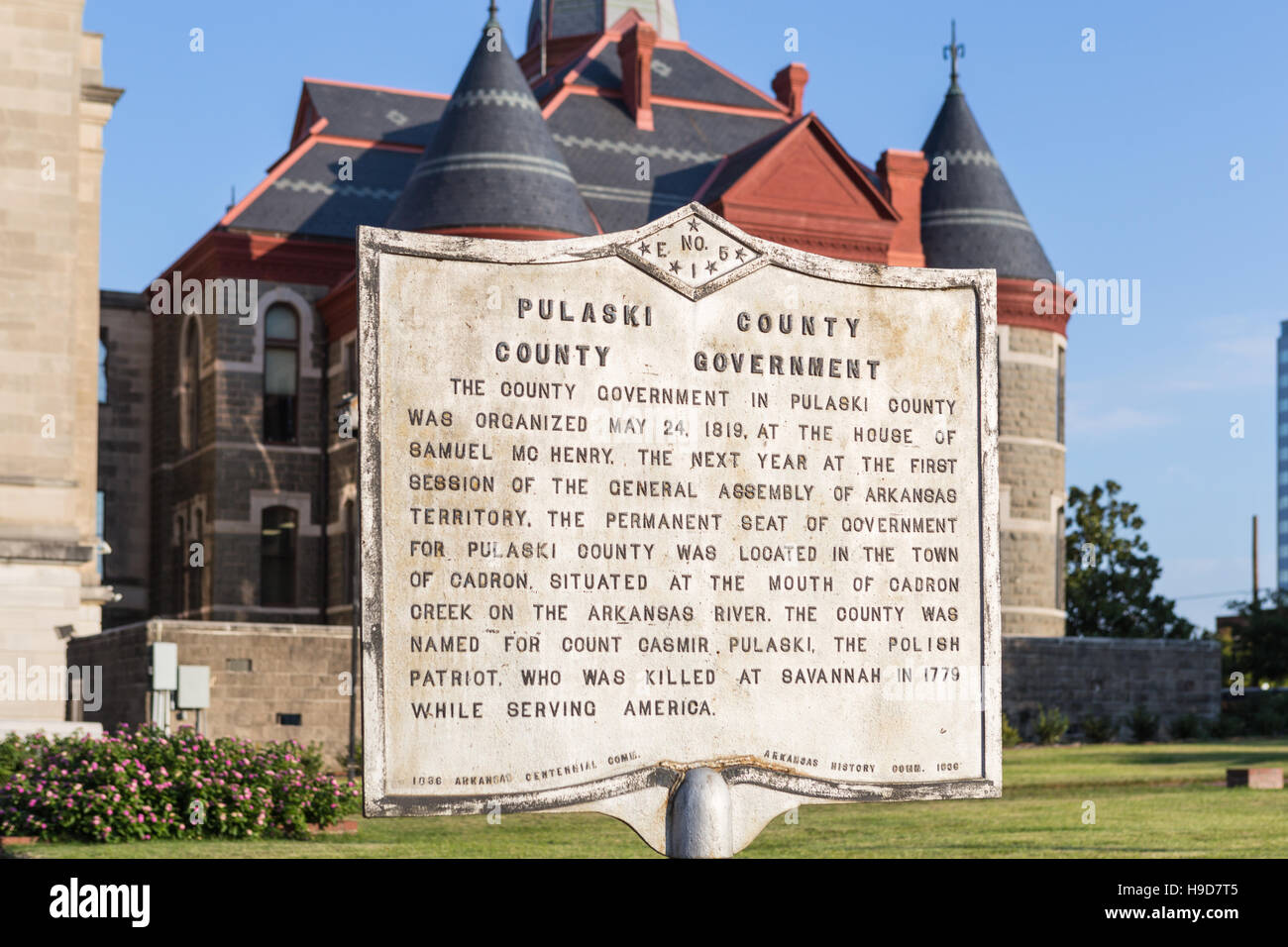 A historical marker summarizes the history of Pulaski County government outside the courthouse in Little Rock, Arkansas. - Stock Image