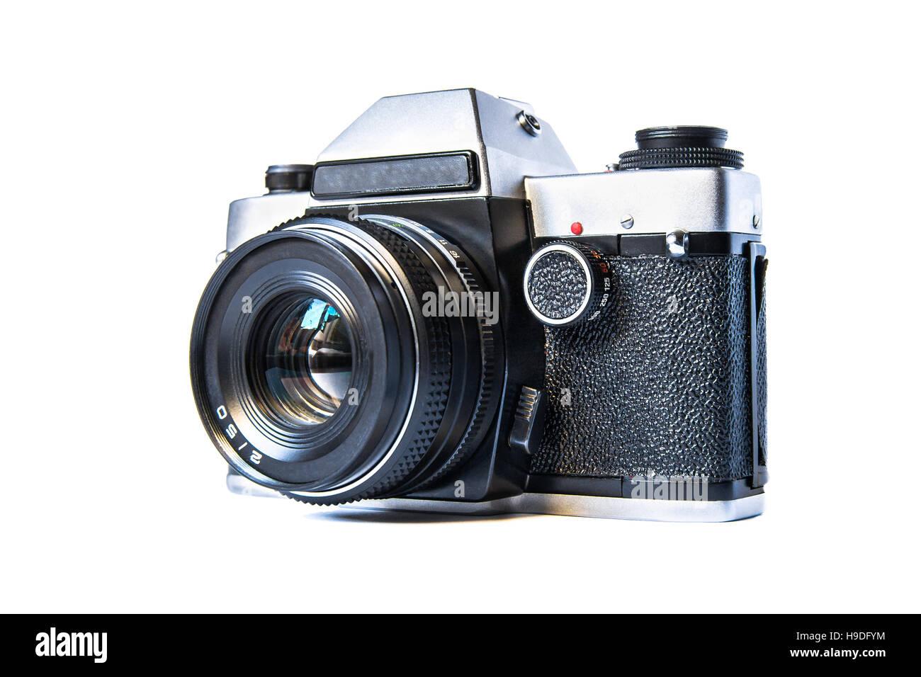 Retro film photo camera isolated on white background - Stock Image