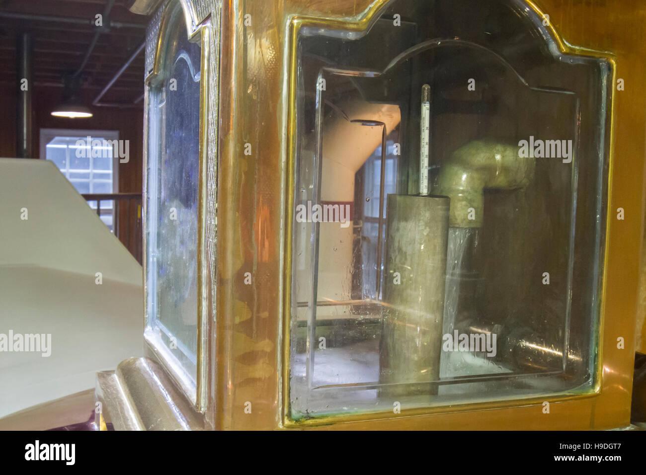 Close up of white lightening inside copper still at bourbon distillery. - Stock Image