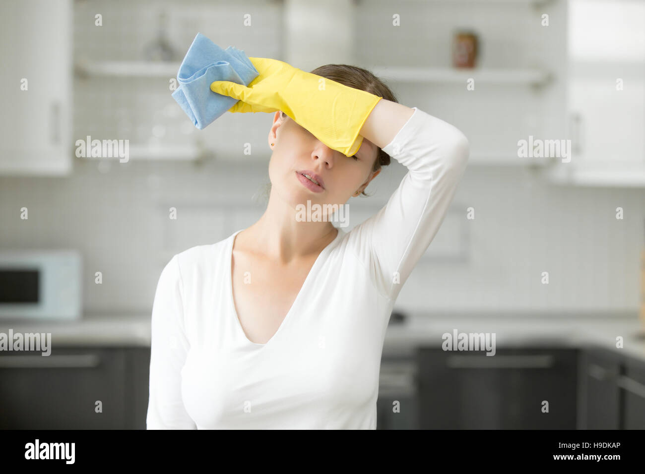 Woman, frustrated with work about the house - Stock Image