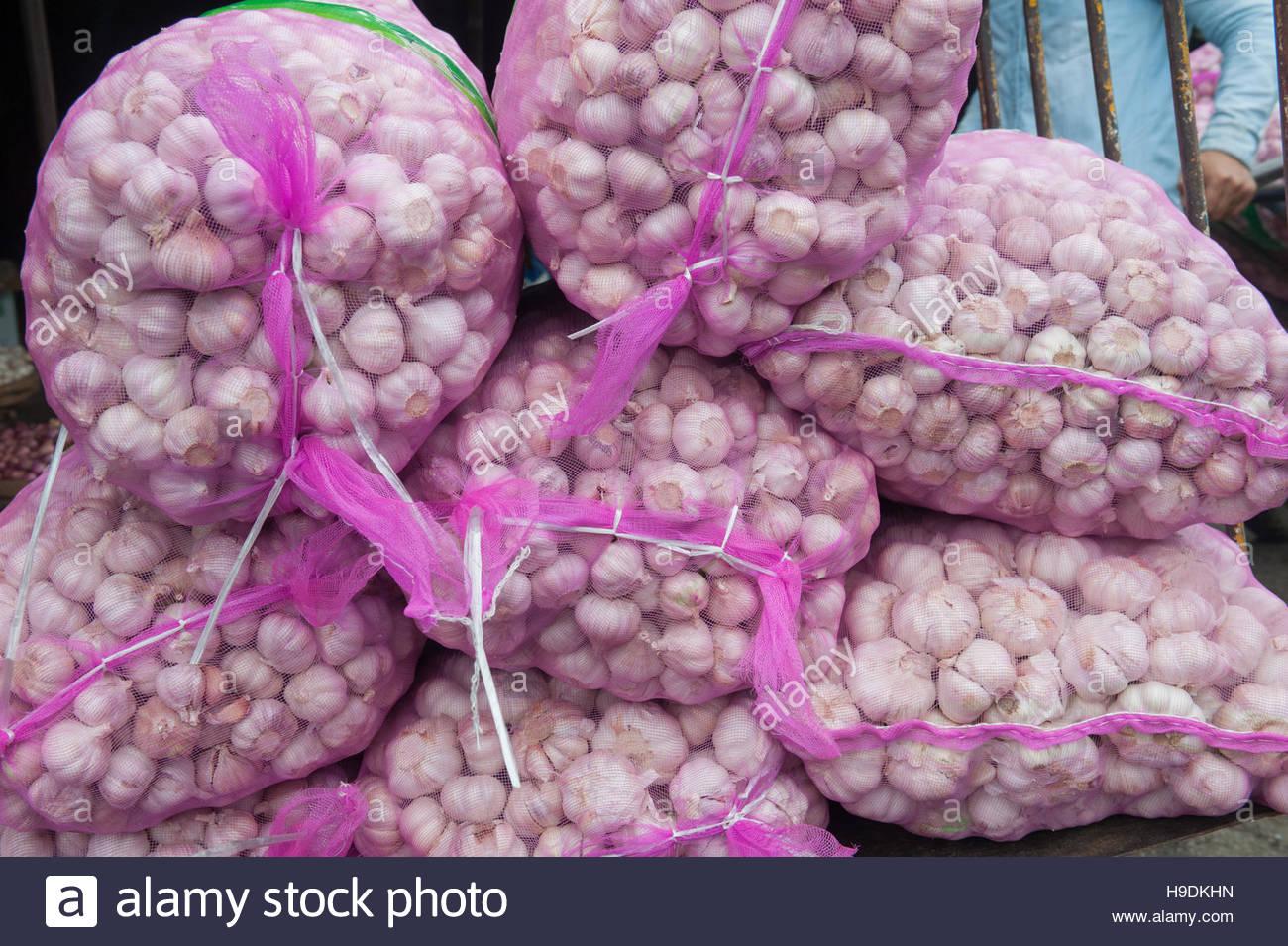 Hue Vietnam Huge sacks of garlic for sale at the Dong Ba Market. - Stock Image