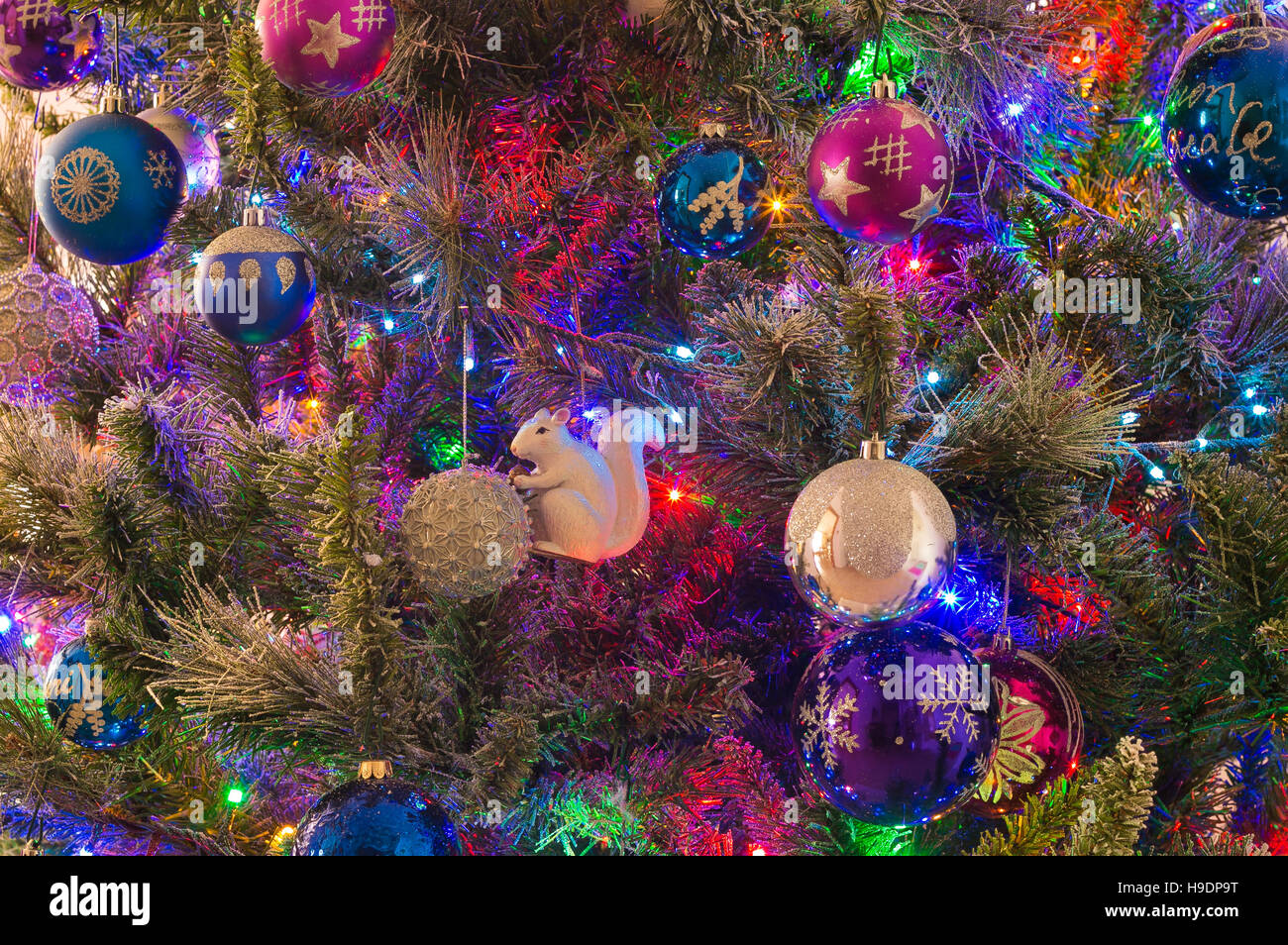 Detail of beautiful christmas tree with decorations and lights - Stock Image