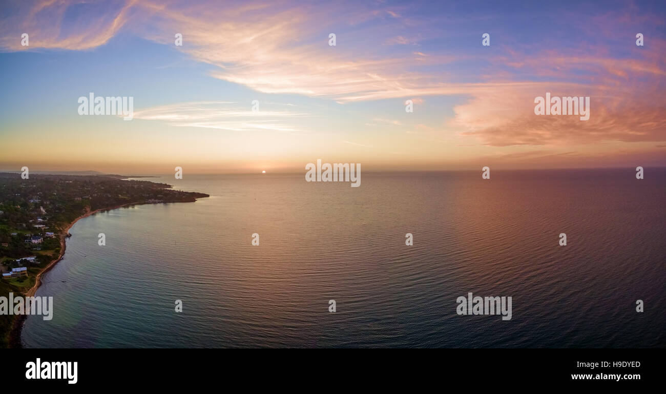 Aerial panorama of beautiful sunset over Mornington Peninsula coastline. Melbourne, Australia. Stock Photo