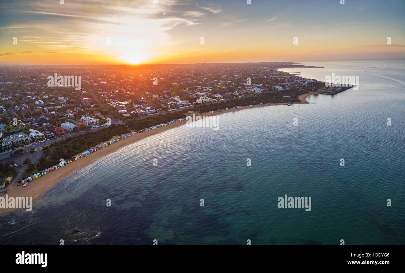 Aerial view of sunrise at Brighton Beach showing the suburb and bathing boxes. Melbourne, Victoria, Australia - Stock Image