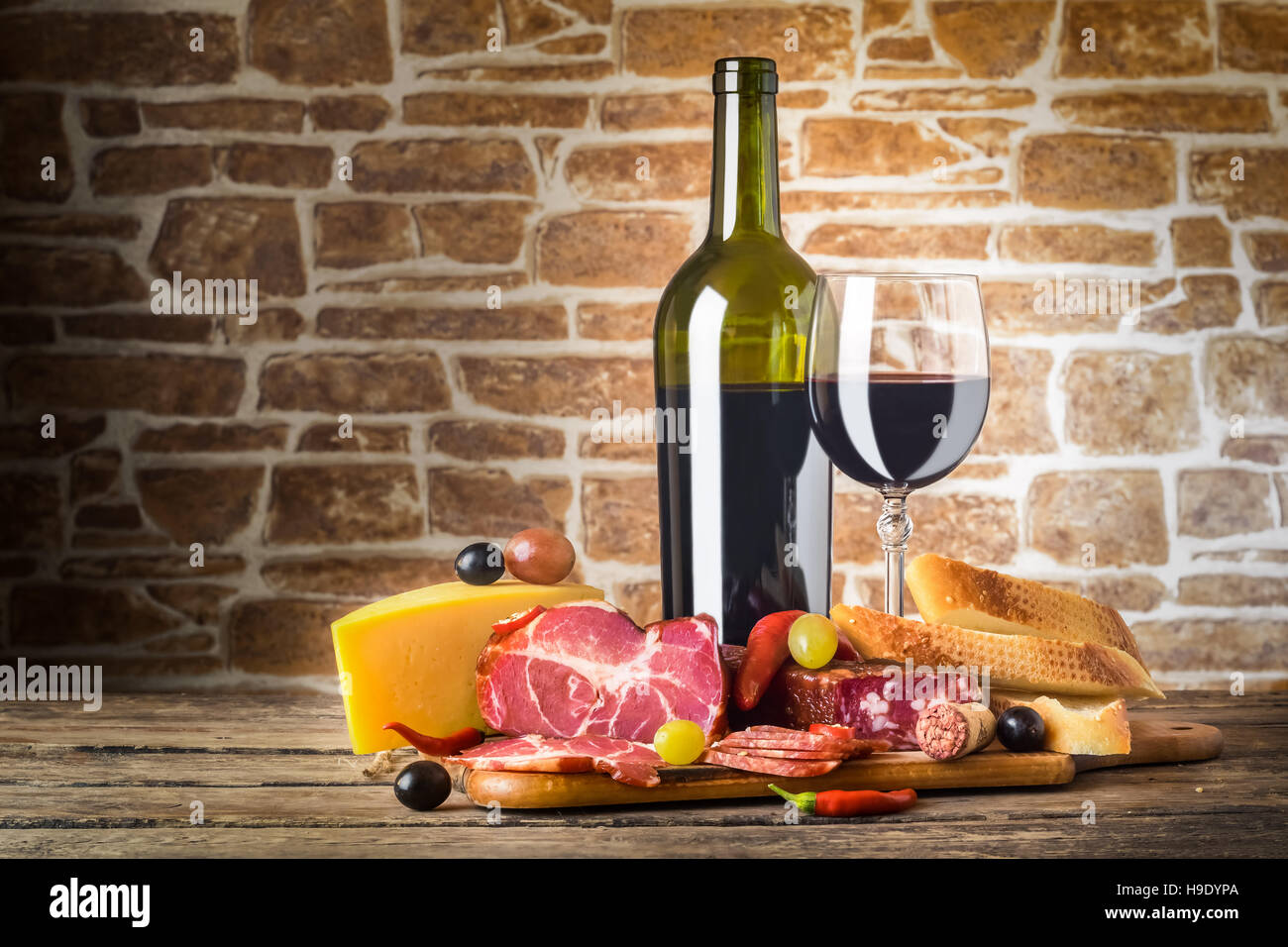 Wine Cheese And Meat On A Wooden Rustic Table Food Background
