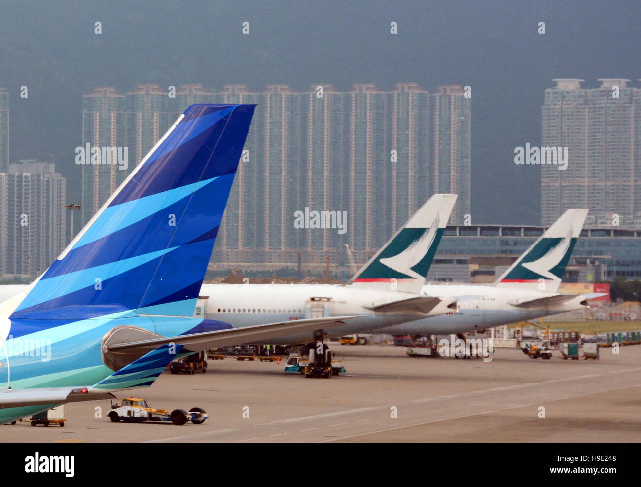 Garuda Indonesia Cathay Pacific planes in Hong Kong international airport China - Stock Image