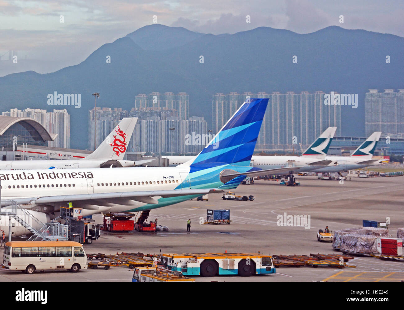 Garuda Indonesia Dragonair Cathay Pacific planes Hong Kong international airport - Stock Image