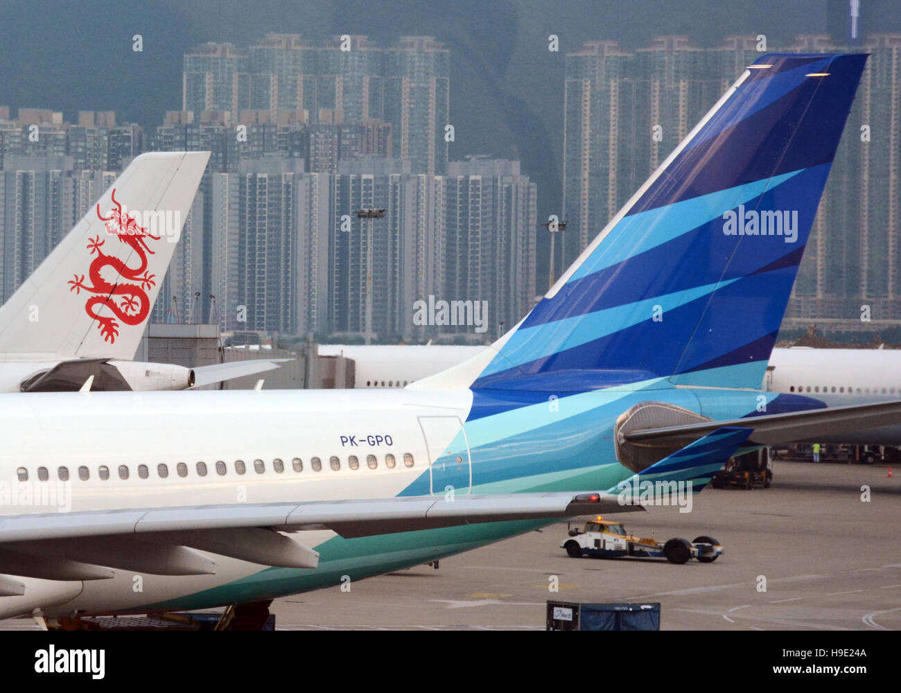 Garuda Indonesia Dragonair planes Hong Kong international airport - Stock Image