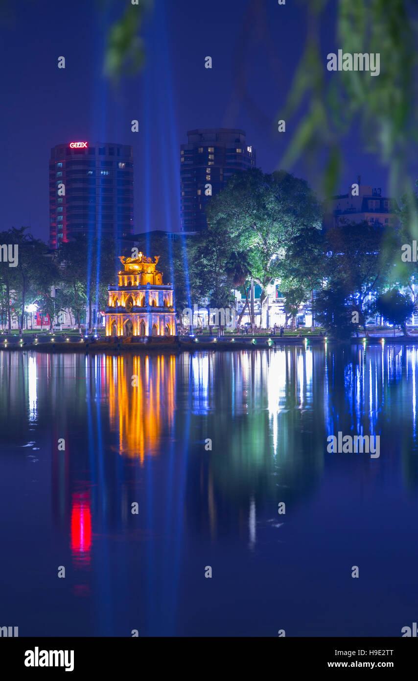 Turtle Tower (Thap Rua) on Hoan Kiem Lake at dusk, Hanoi, Vietnam - Stock Image