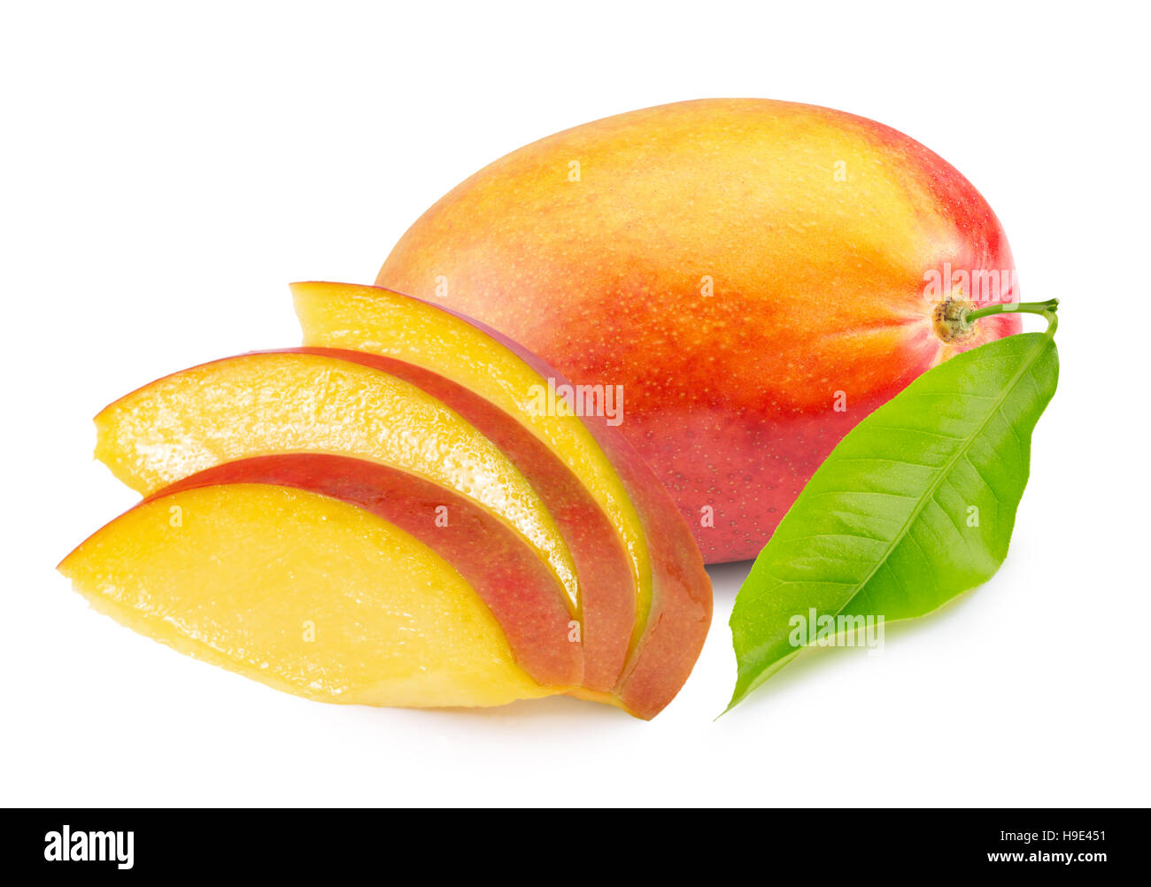 mango with slices isolated on the white background. - Stock Image