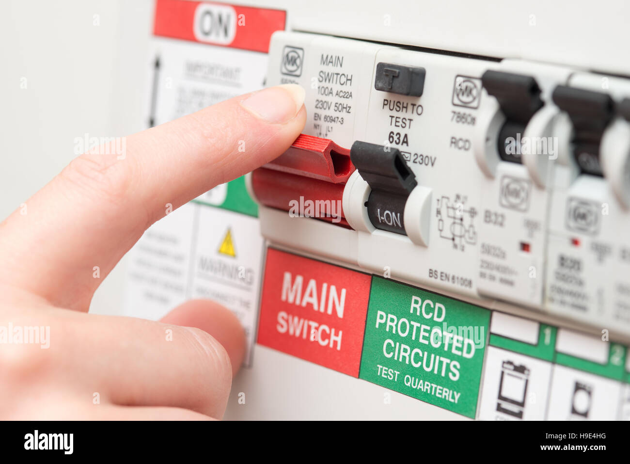Circuit Breaker Domestic Stock Photos Breakers All About Alert A Finger Is To Switch Off Large Red Mains On An Rcd