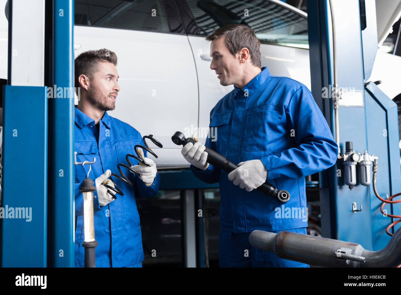 Professional mechanics reparing car - Stock Image