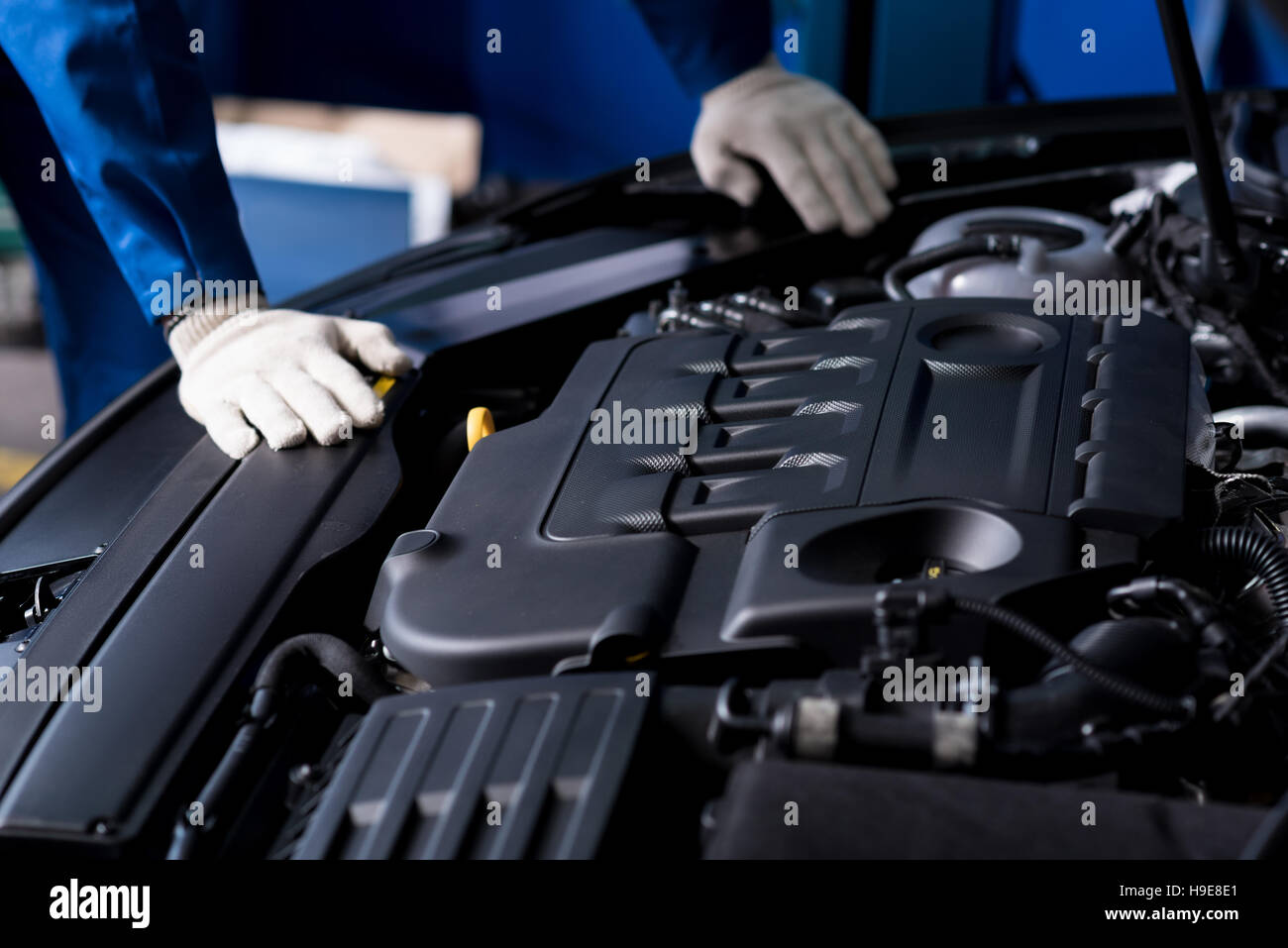 Professional mechanic checking car engine - Stock Image