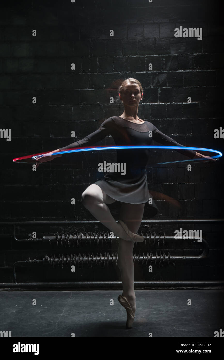 Pleasant gymnast performing with a colorful gymnastic ribbon - Stock Image