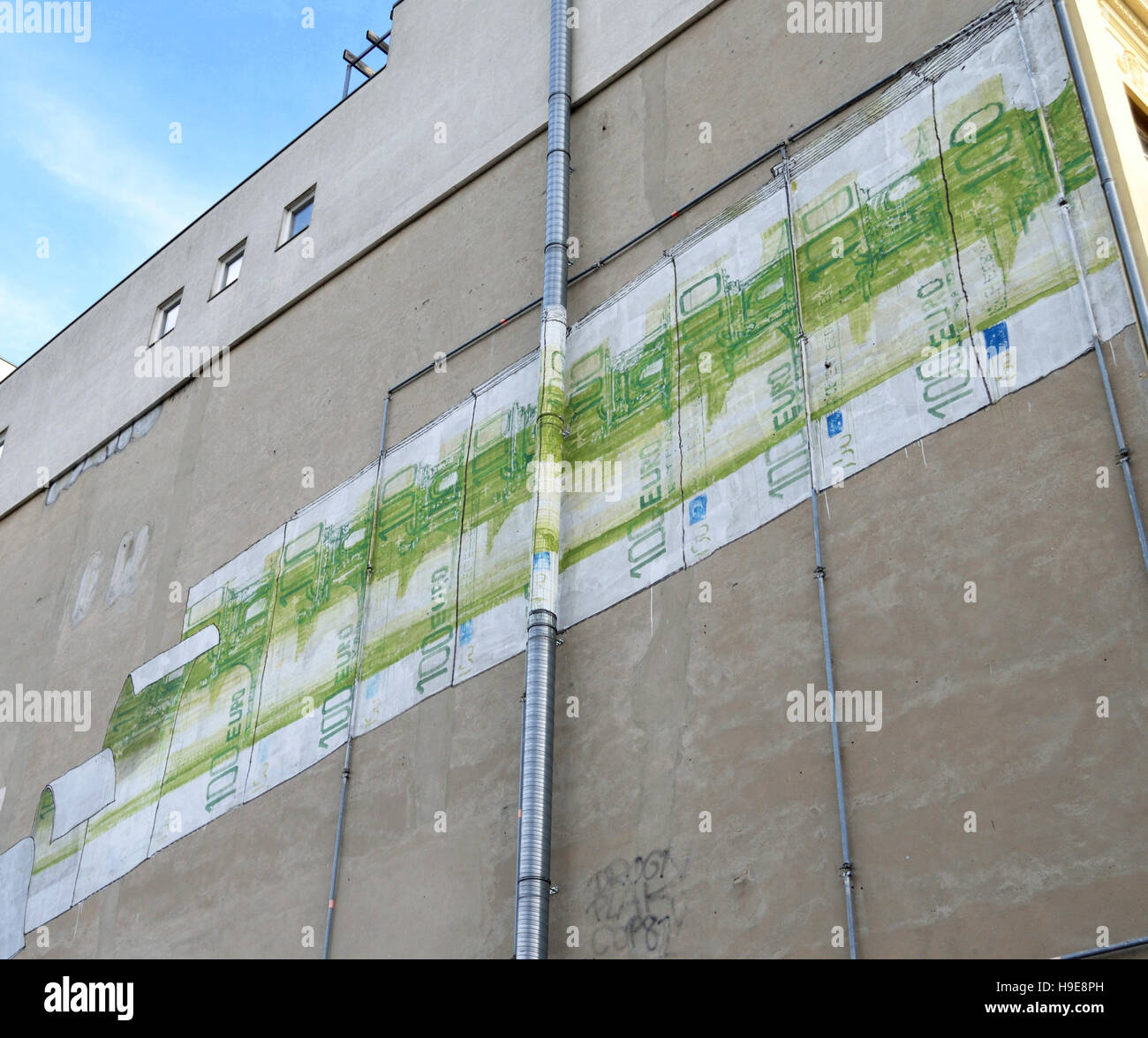 Graffiti by Italian artist Blu on a building in Berlin Kreuzberg district. - Stock Image
