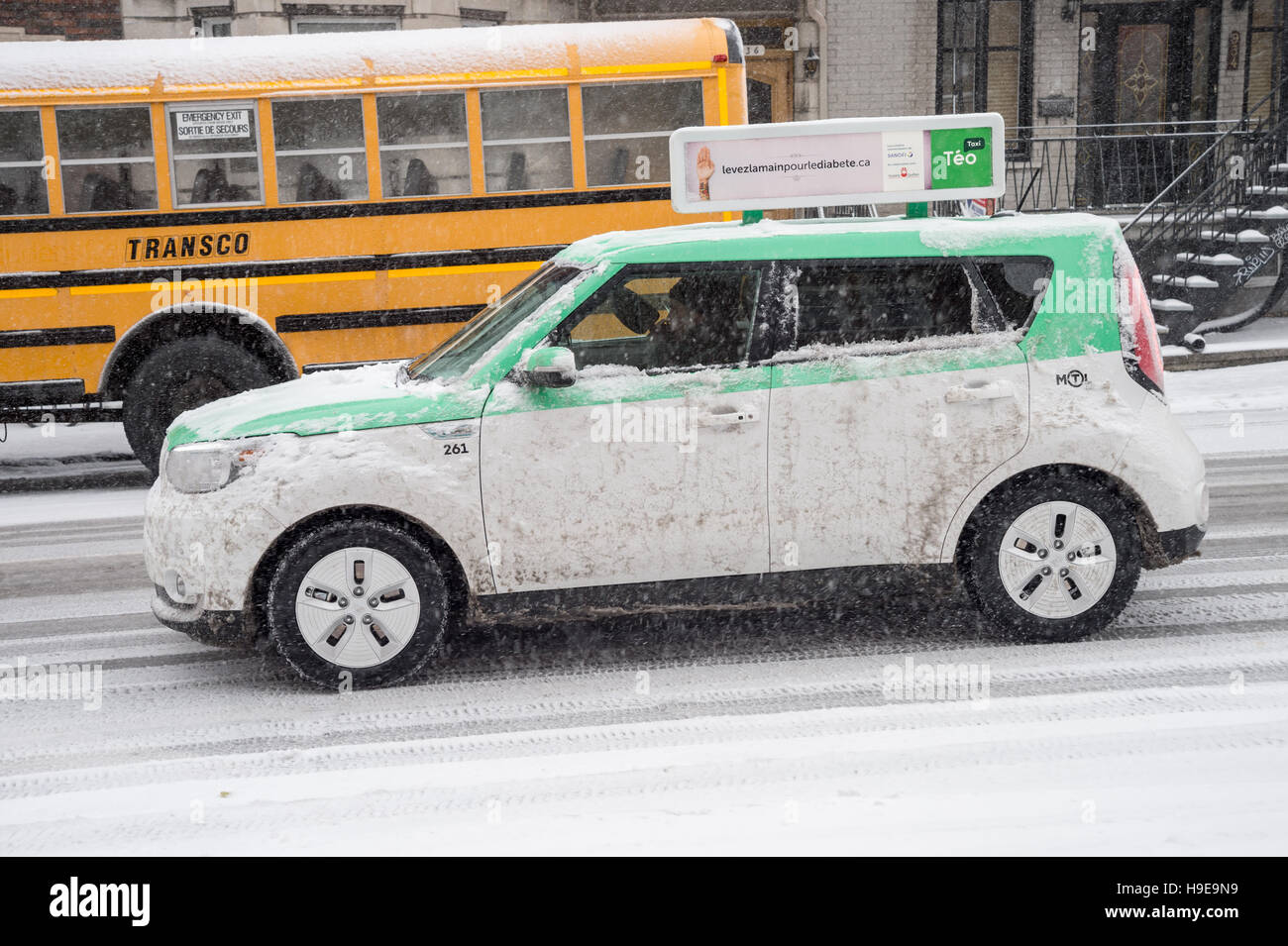 Teo Taxi's electric cabs in Montreal - Stock Image
