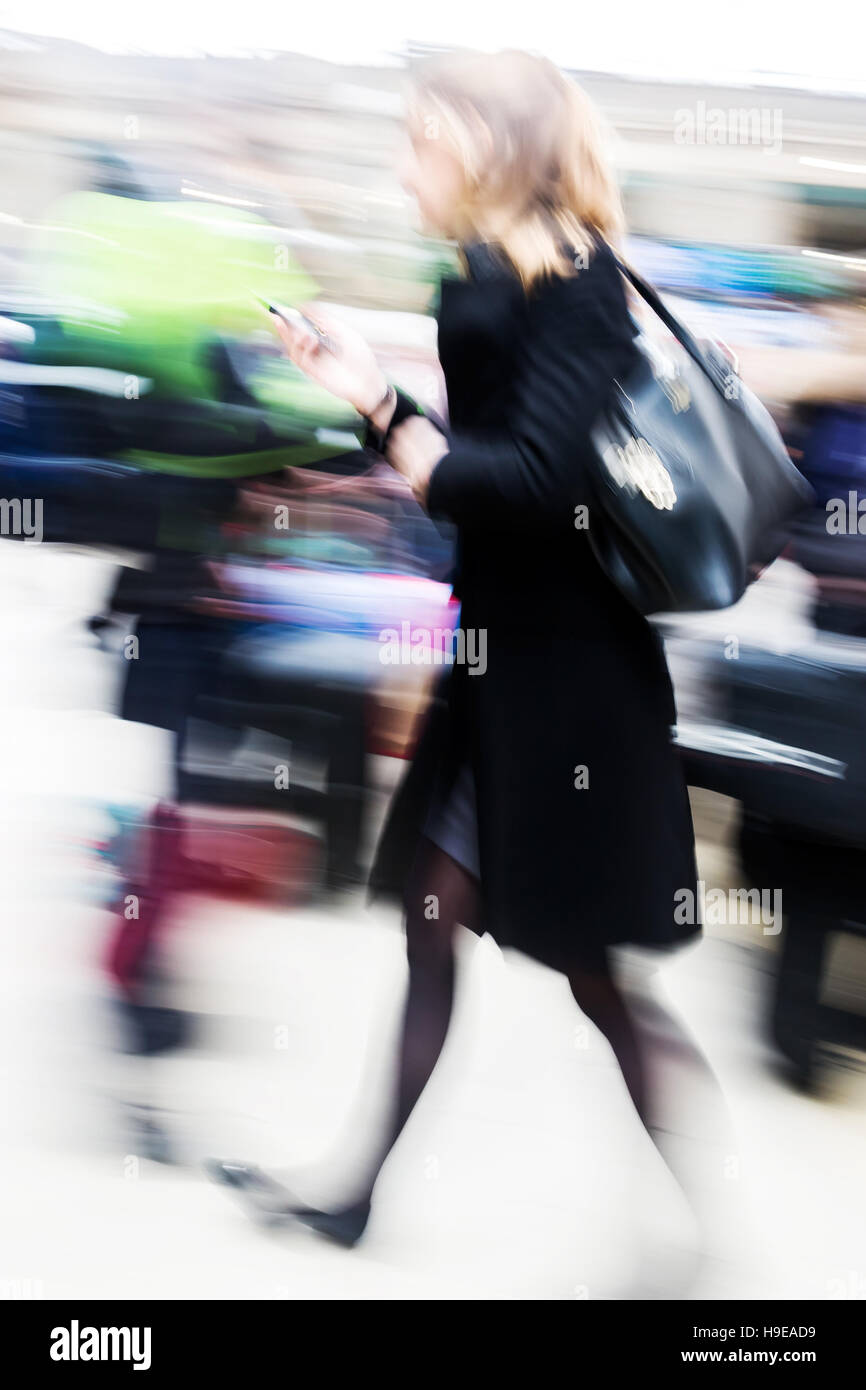 traveling woman in motion blur at the railway station - Stock Image