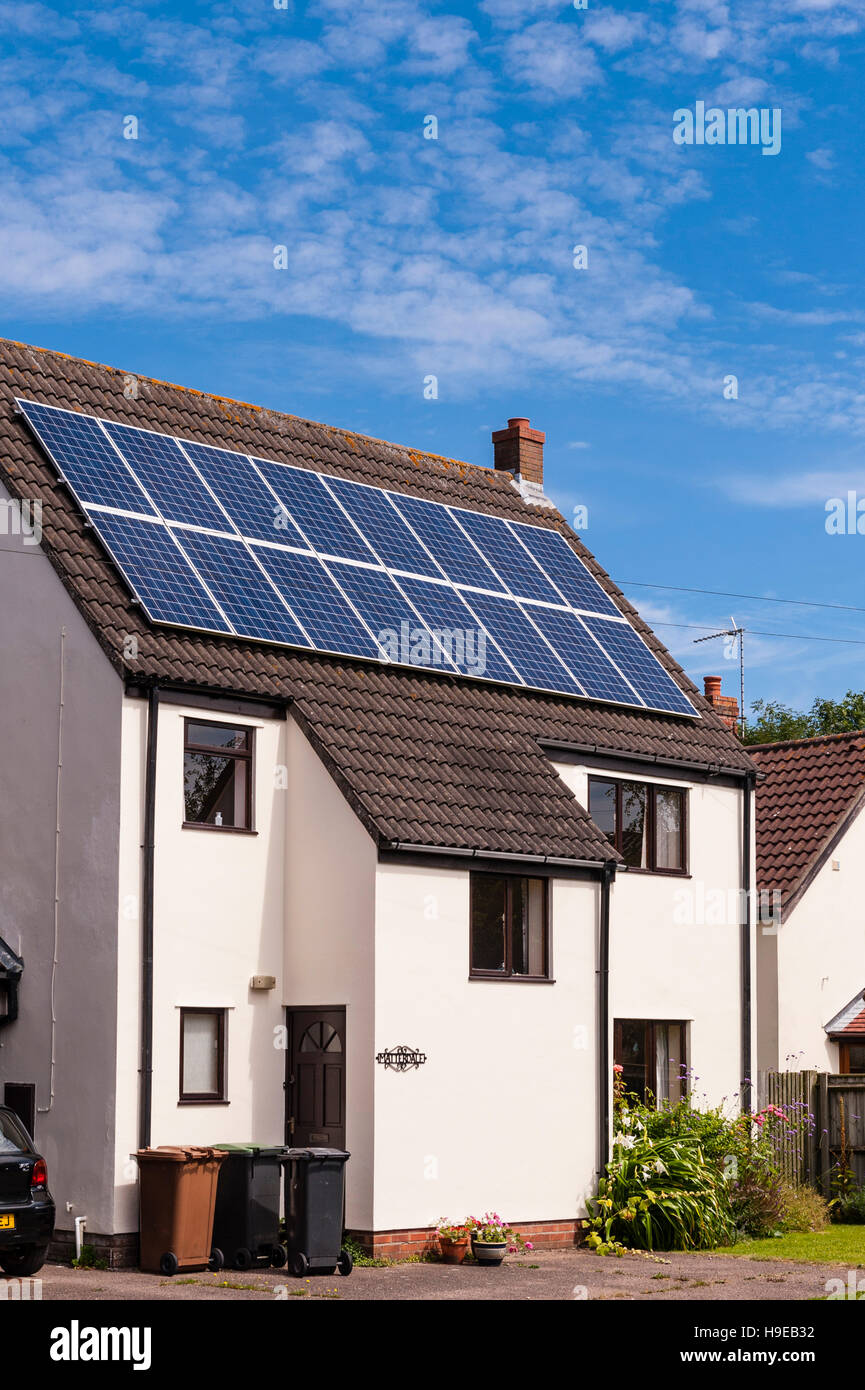 Solar Panels on the roof of a domestic property in Fressingfield , Suffolk , England , Britain , Uk - Stock Image