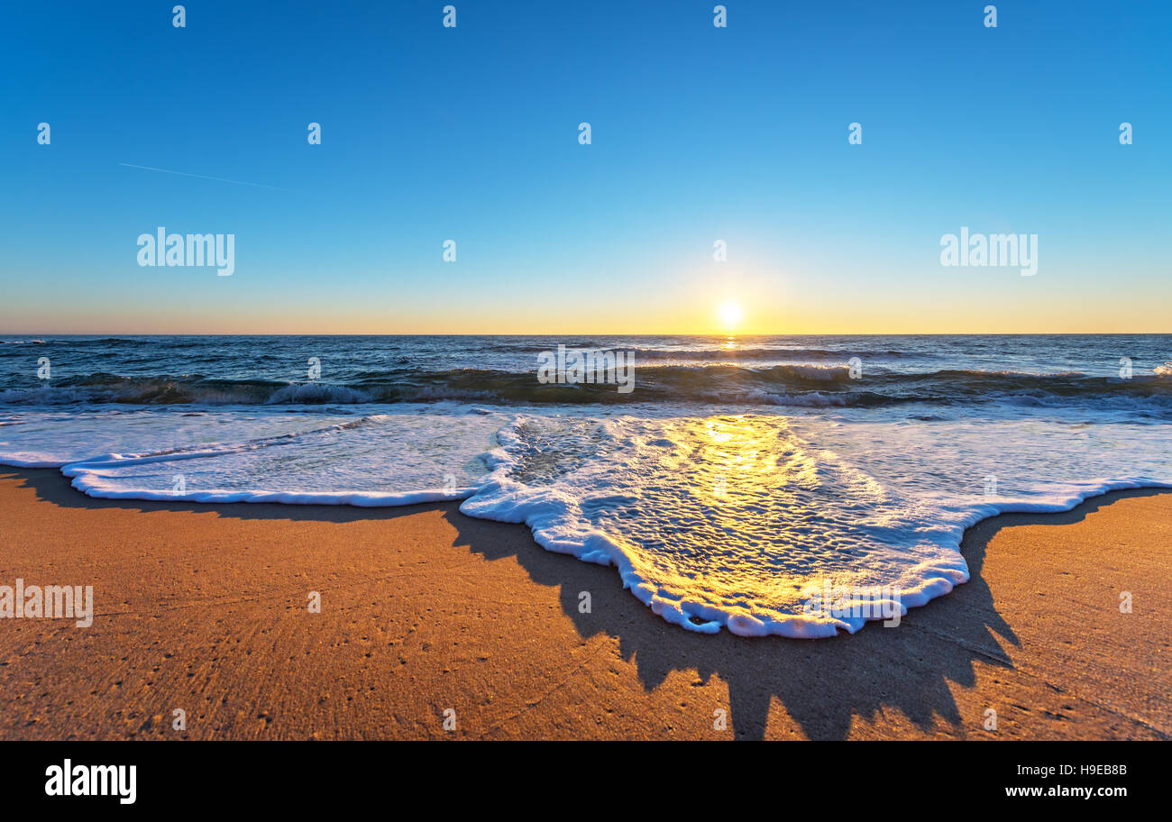 Early morning, sunrise over sea. - Stock Image