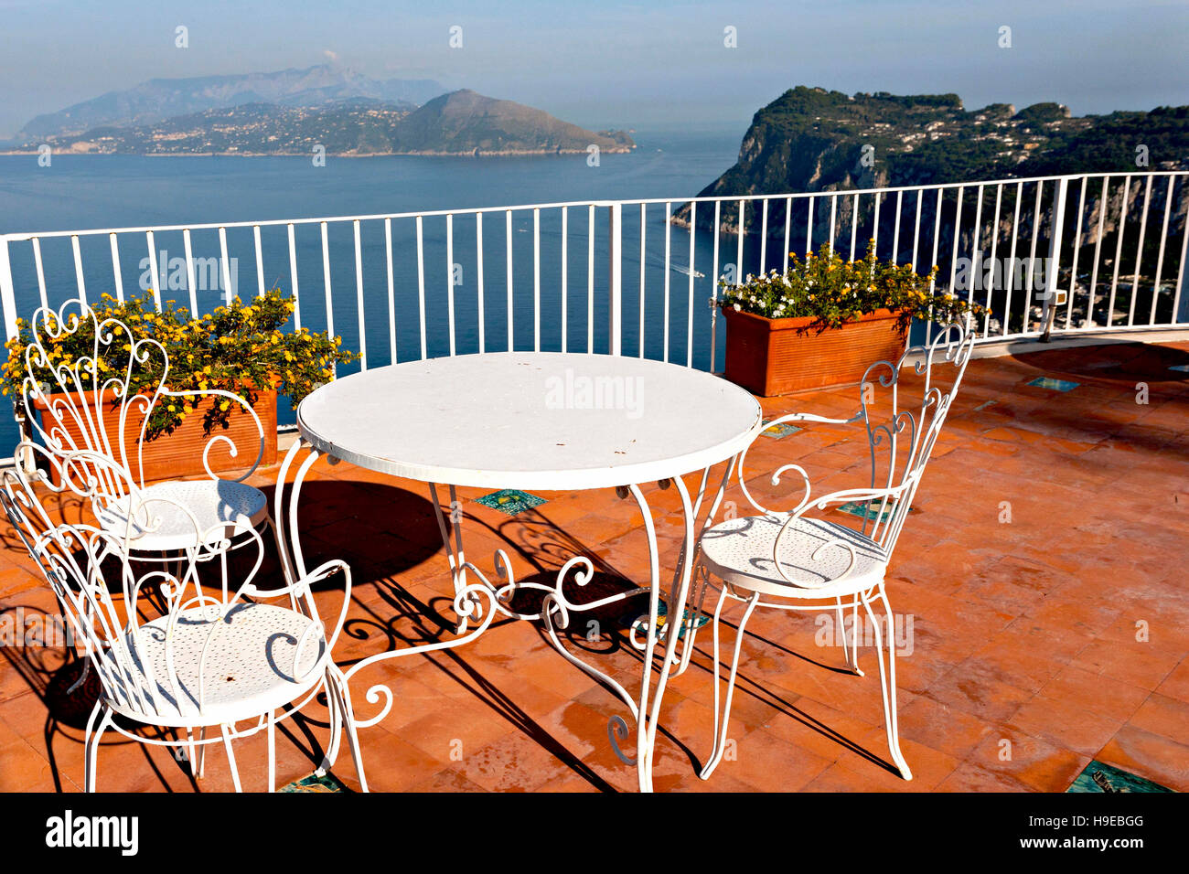Balcony Outdoor Table And Chairs Setting With View Over The Bay Of Naples  And Ischia, Capri, Campania, Italy, Europe