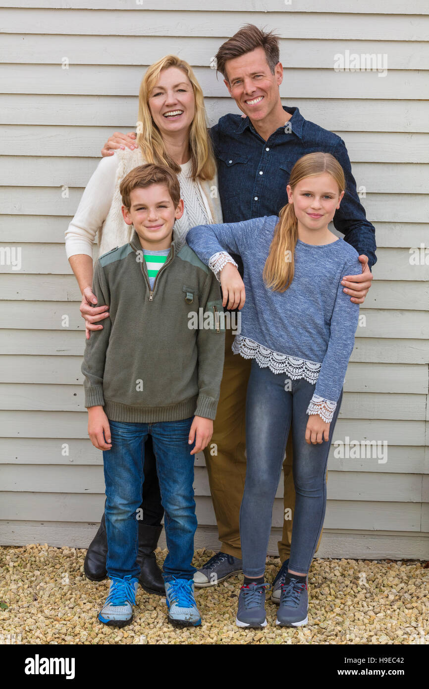Portrait shot of an attractive, successful and happy family, man, woman, girl and boy child, mother, father, son Stock Photo