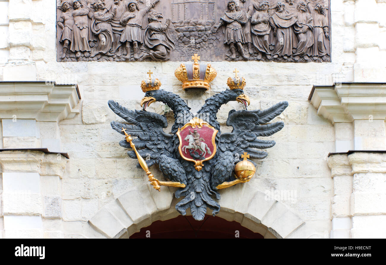The double headed eagle from the Russian Federation coat of arms above a gate entering the Peter and Paul Fort. - Stock Image