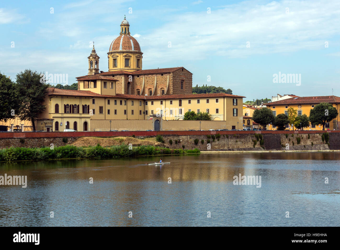 View over the River Arno towards the Basilica di Santo Spirito (Basilica of the Holy Spirit) in Florence, Italy. Stock Photo