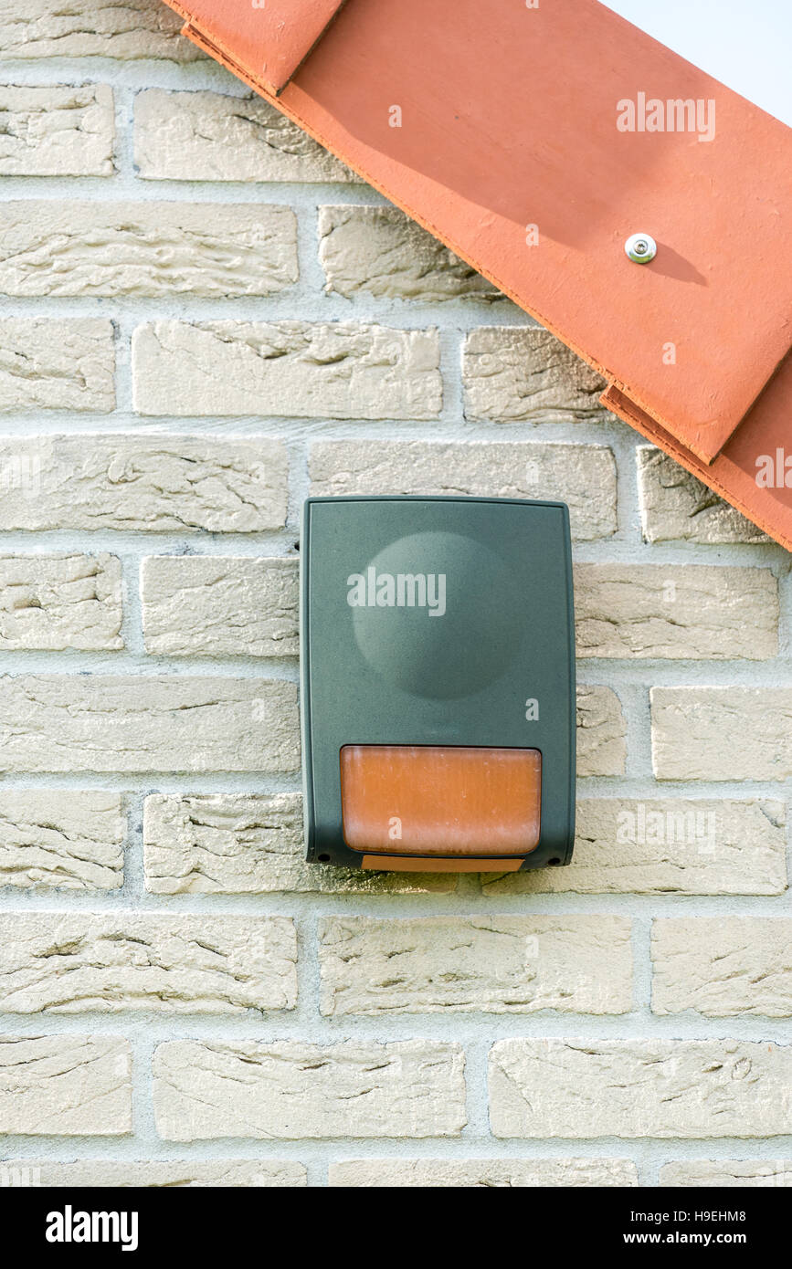 Alarm in a wall of house - Stock Image