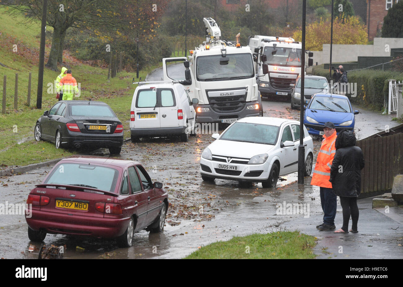 The clean up begins in Whitchurch Lane, Bristol, after heavy rain  overnight, as