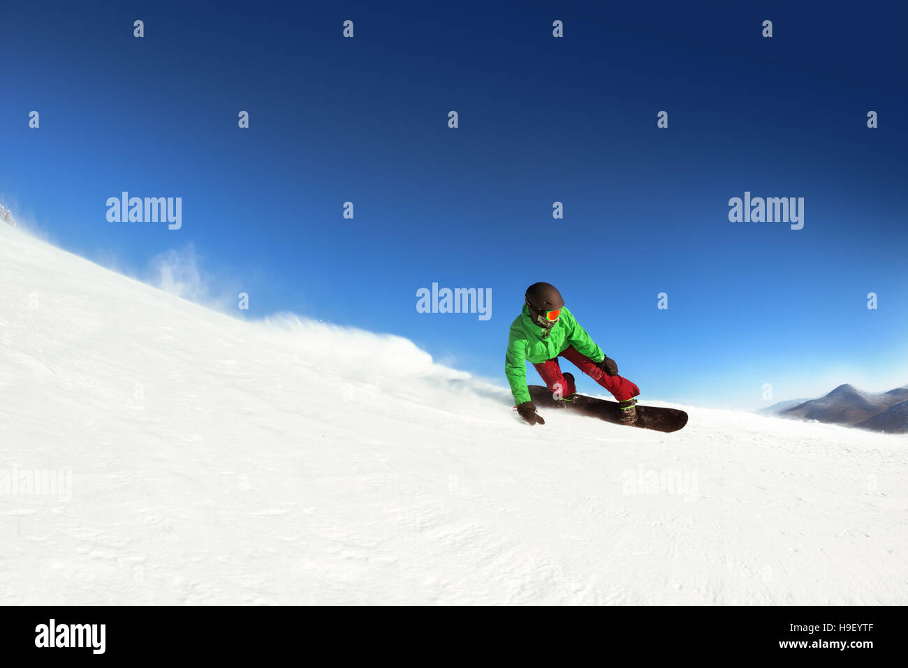 Man snowboarder rides slope sheregesh. Space for text - Stock Image