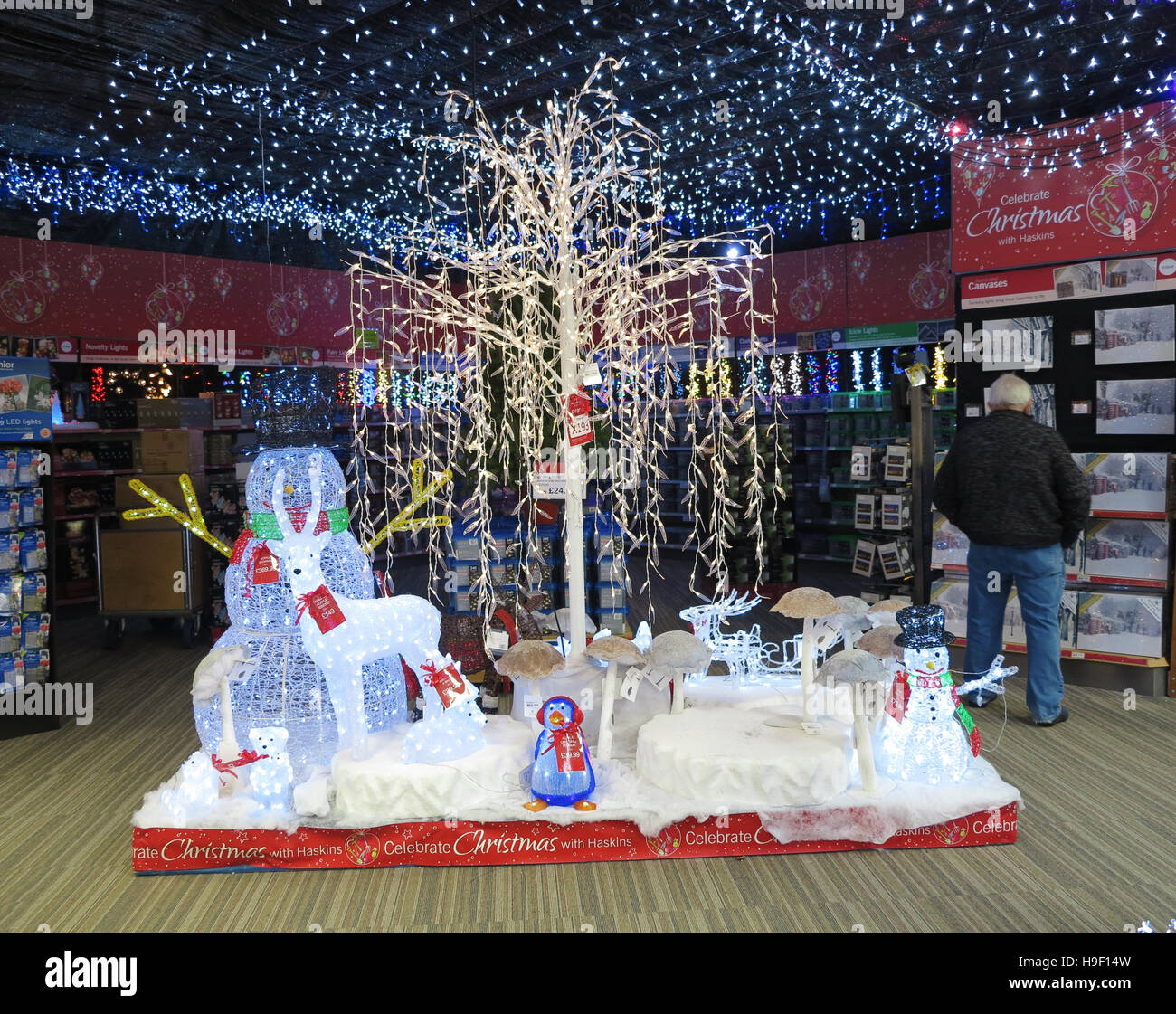 large display of christmas ornaments in uk garden centre stock image