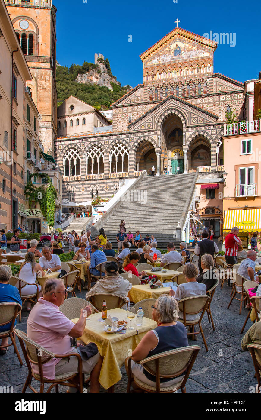Outdoor cafes in Piazza Duomo below the cathedral , Amalfi, Campania, Italy - Stock Image